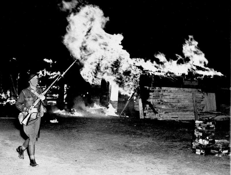 Federal troops burn Bonus Marchers' tents