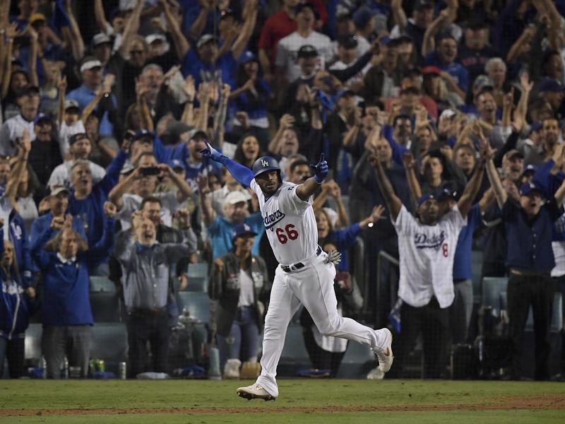 Los Angeles Dodgers' Yasiel Puig celebrates after his three-run home run