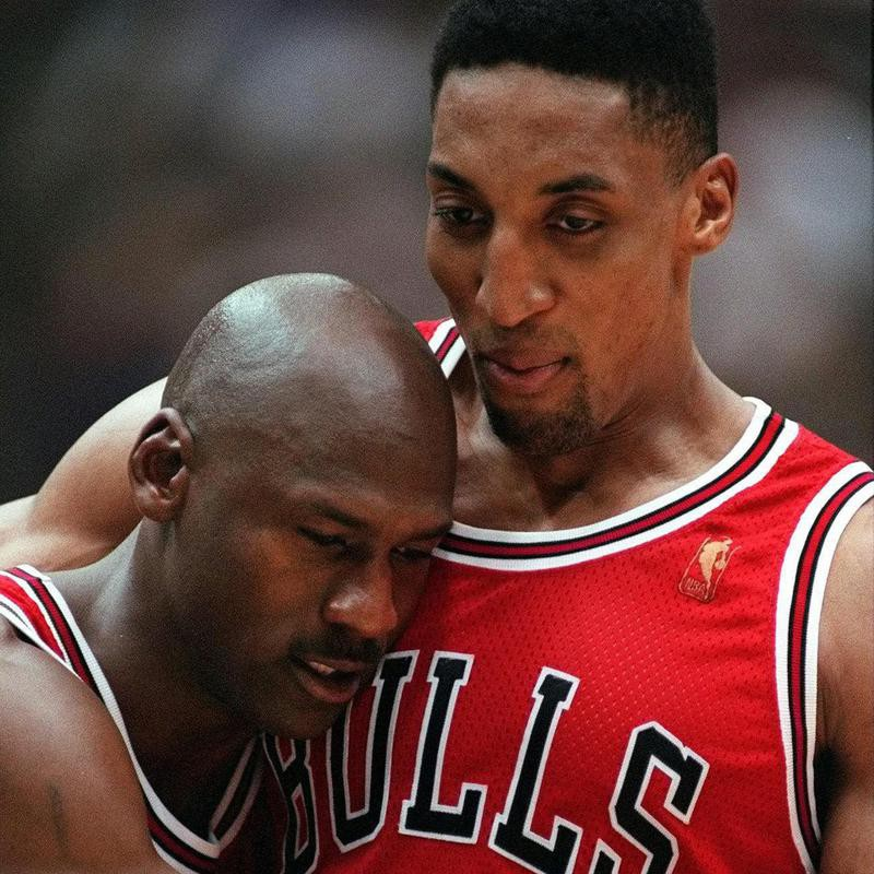 Chicago Bulls' Scottie Pippen embraces exhausted Michael Jordan