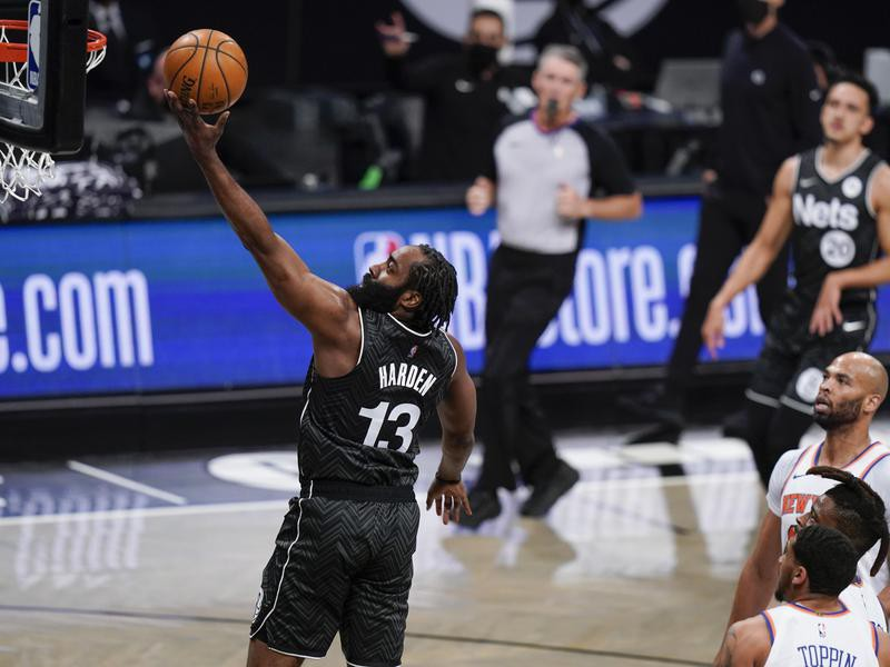 James Harden of the Brooklyn Nets drives past Knicks
