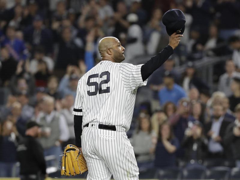 New York Yankees starting pitcher CC Sabathia gestures to fans