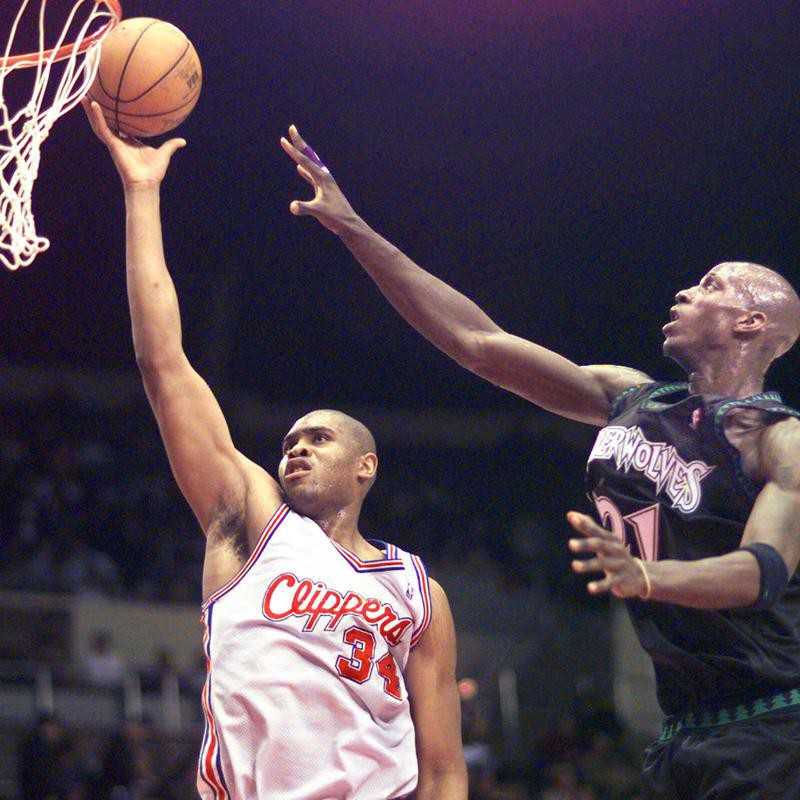 Los Angeles Clippers' Michael Olowokandi lays one into the hoop