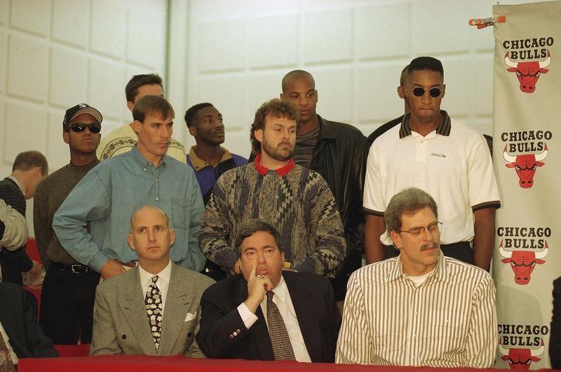 John Paxson watches with members of Chicago Bulls as Michael Jordan retires