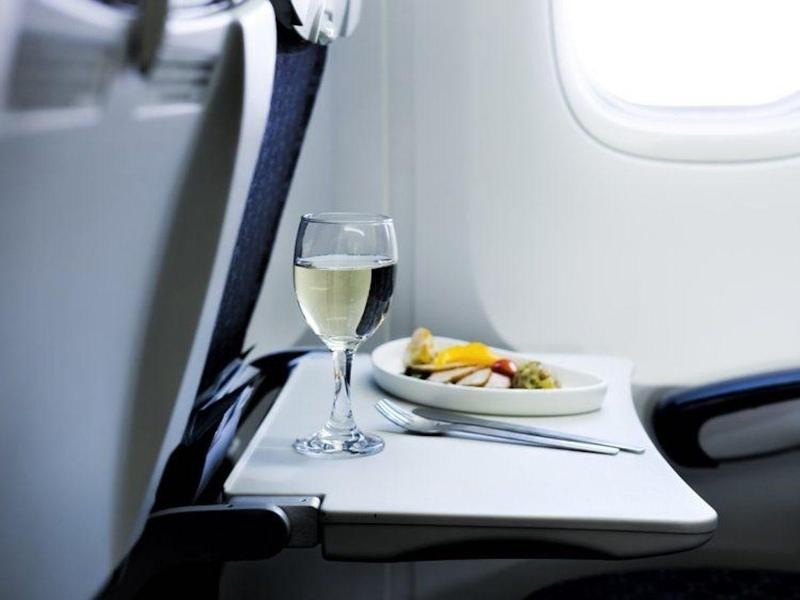 Wine and snacks on a plane