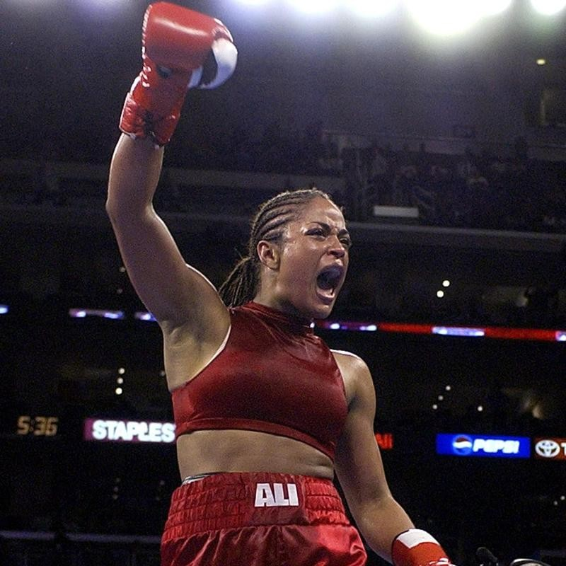 Laila Ali celebrates victory against Valerie Mahfood in Los Angeles