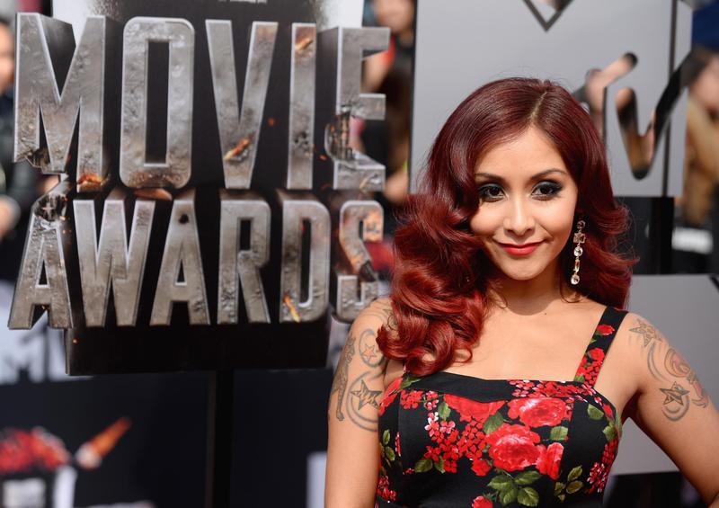 "Nicole ""Snooki"" Polizzi arrives at the MTV Movie Awards in 2014."