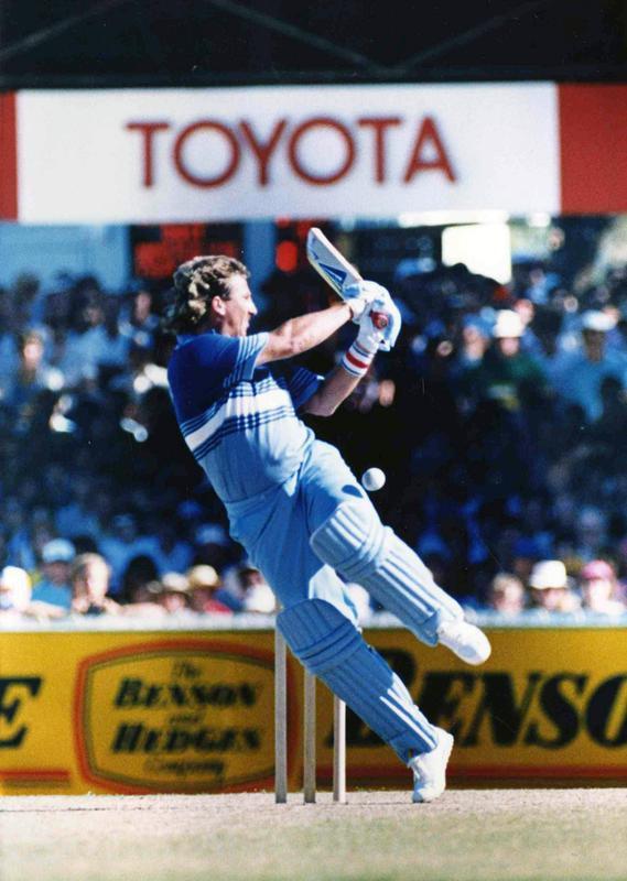 Ian Botham slams ball away