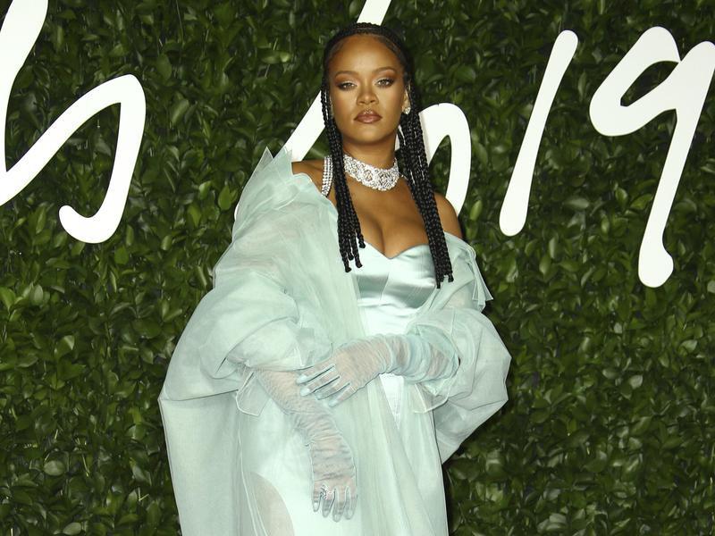 Rihanna poses at Britain Fashion Awards