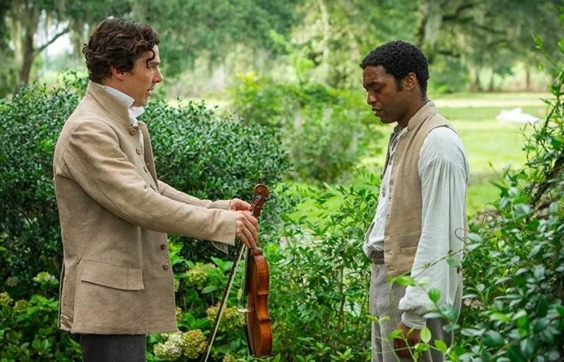 Benedict Cumberbatch offering violin to Chiwetel Ejiofor in 12 Years a Slave