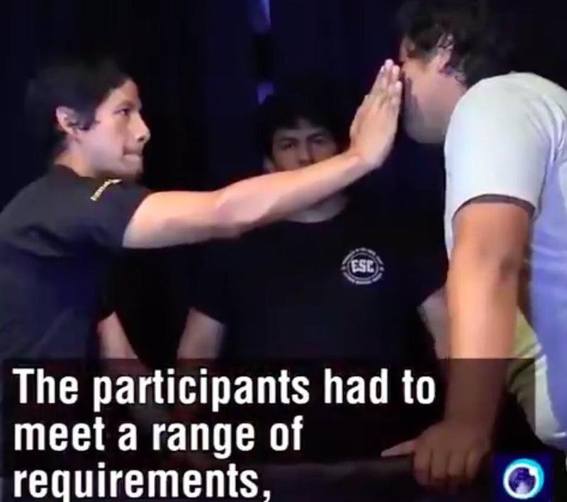 Man slapping other man