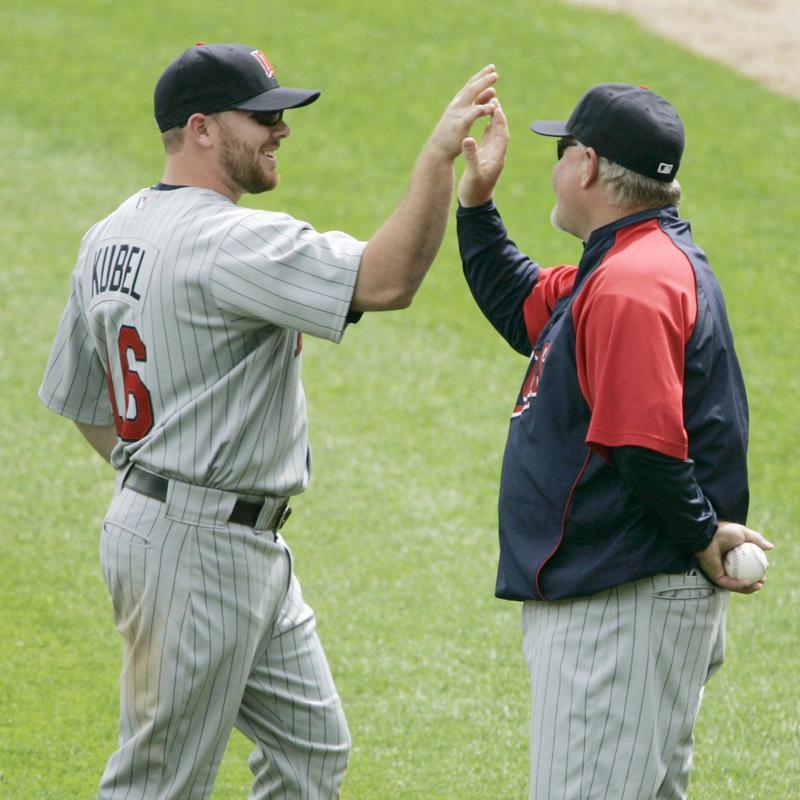 Ron Gardenhire congratulates Minnesota Twins' Jason Kubel