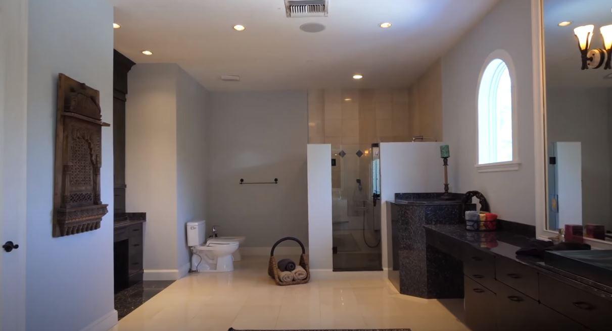 Shaq's bathroom with three toilets