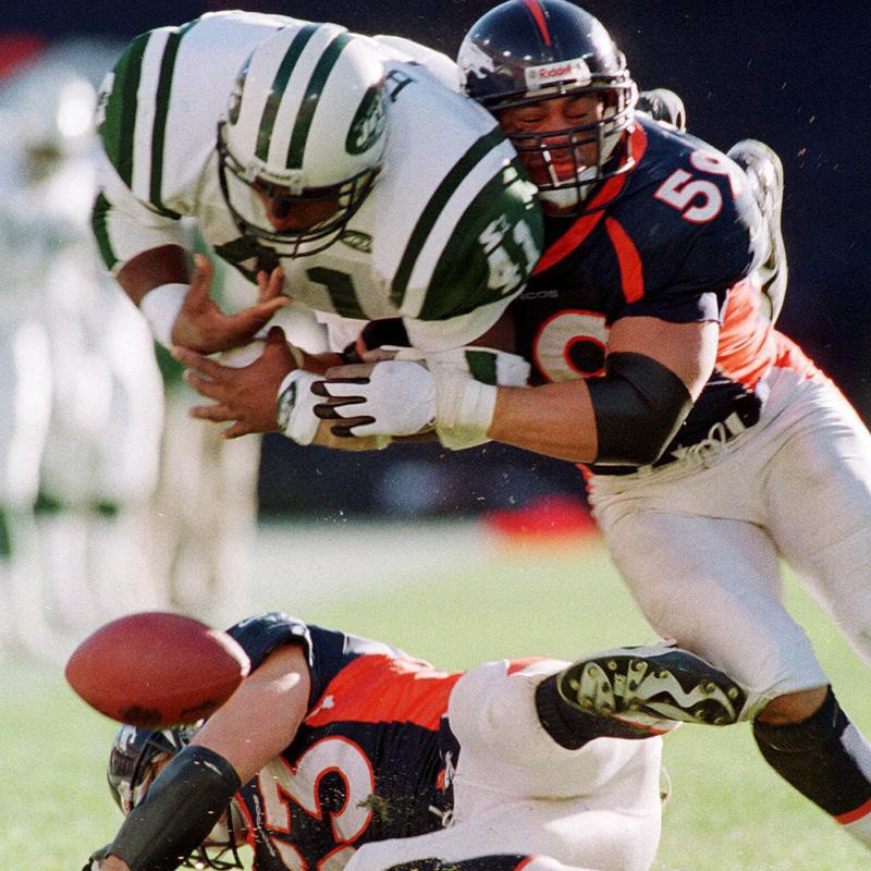 Bill Romanowski forces Keith Bryars of the New York Jets to fumble the ball