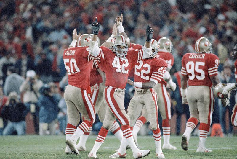 Ronnie Lott and 49ers teammates celebrate