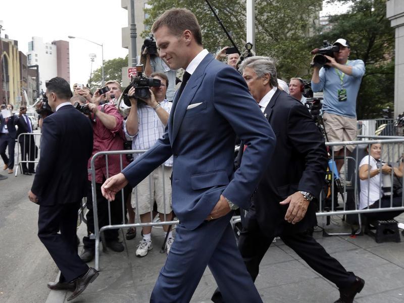 Tom Brady walks out of court