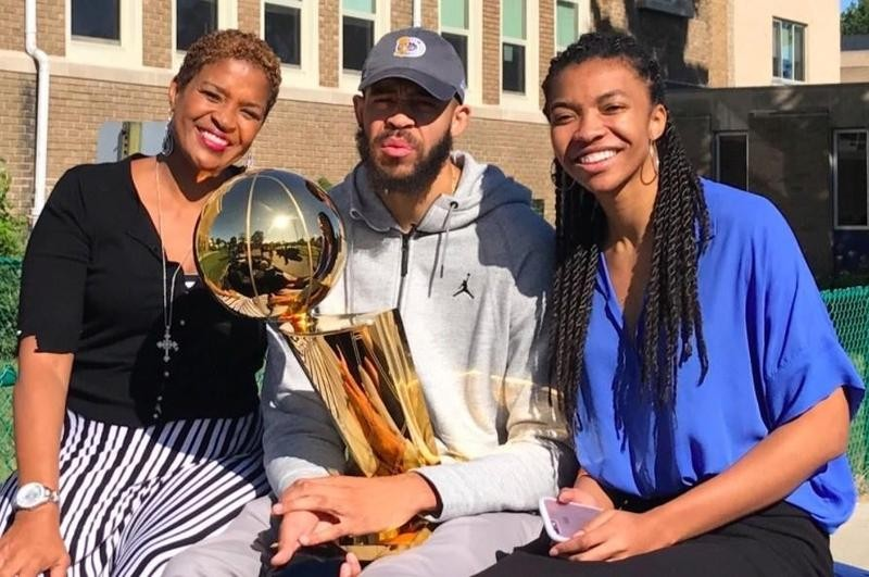 Pam poses with her son JaVale and daughter Imani