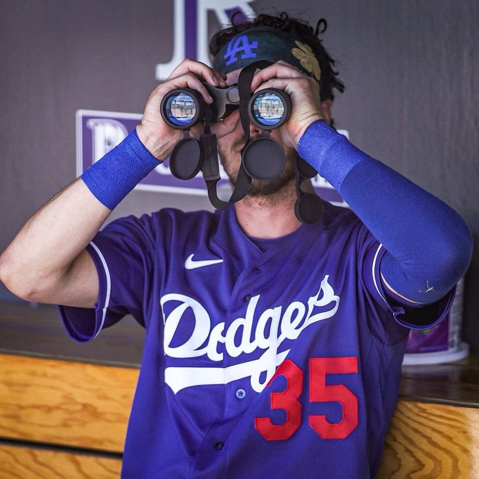 Cody Bellinger looking through binoculars