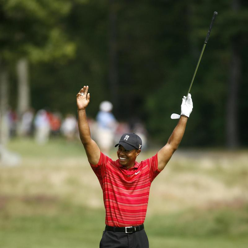 Tiger Woods reacts to his eagle