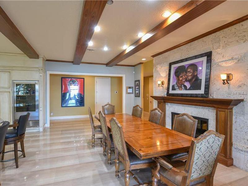 Shaq's kitchen with a painting of Lucille O'Neal