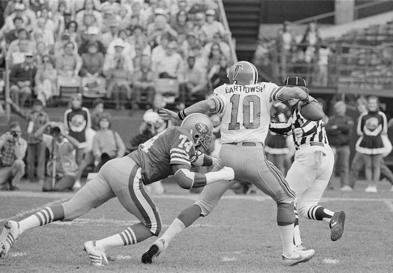 Fred Dean sacks Atlanta Falcons quarterback Steve Bartkowski