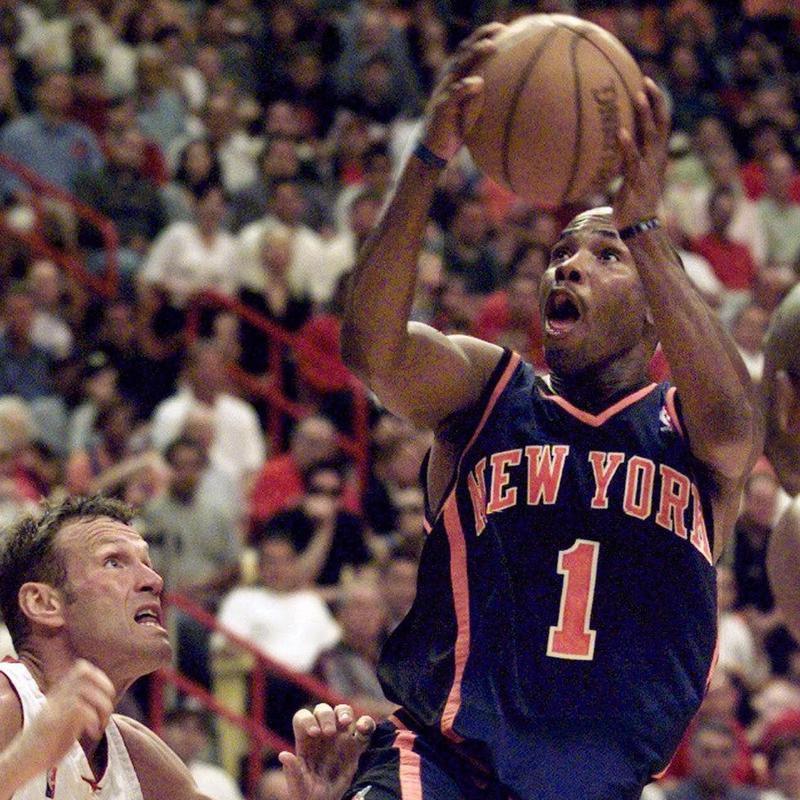 Chris Childs jumps toward the basket past Miami Heat's Dan Majerle