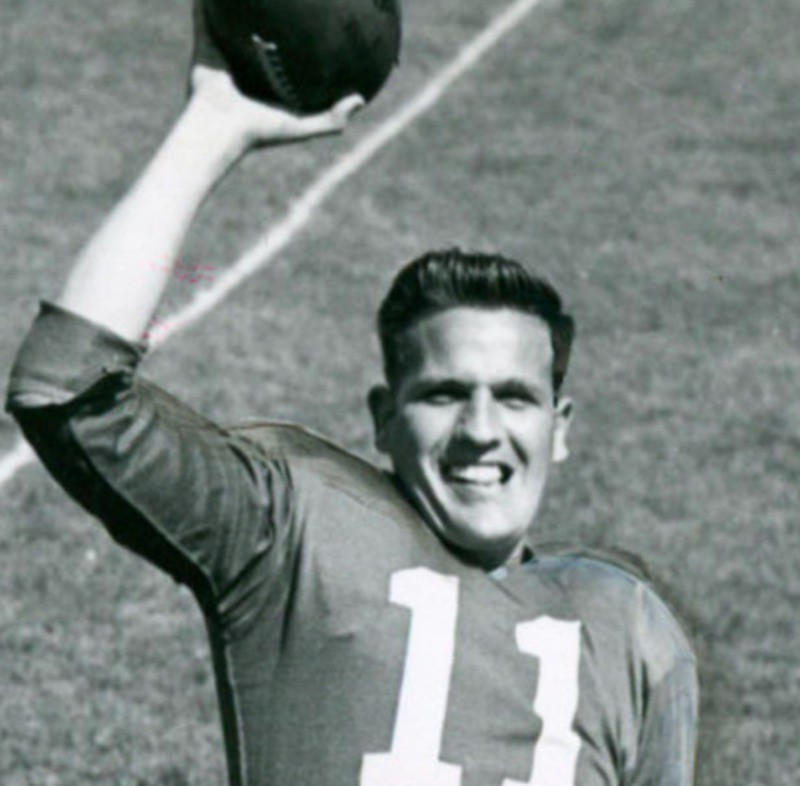 Bobby Thomason smiling with football