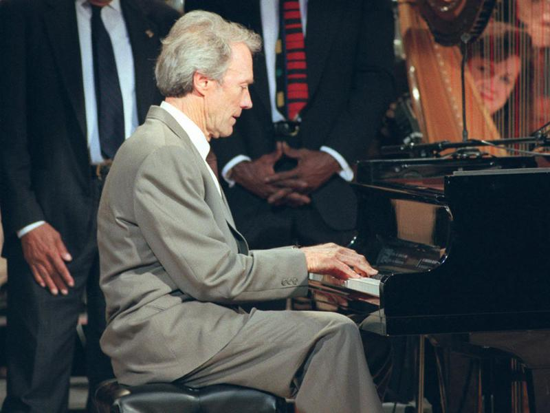 """Clint Eastwood plays piano at """"Eastwood: After Hours, A Night of Jazz"""" in 1996. The event paid tribute to Eastwood's love of jazz, as well as his use of jazz in his movies."""
