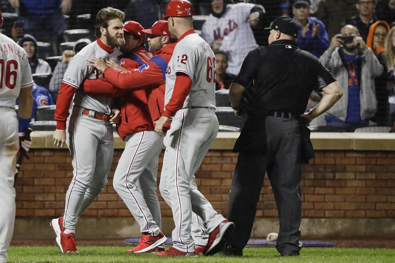 Bryce Harper argues with umpire