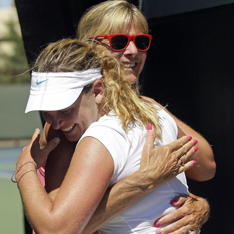 Coco Vandeweghe embraces mother Tauna after winning semifinal of Bank of the West tournament