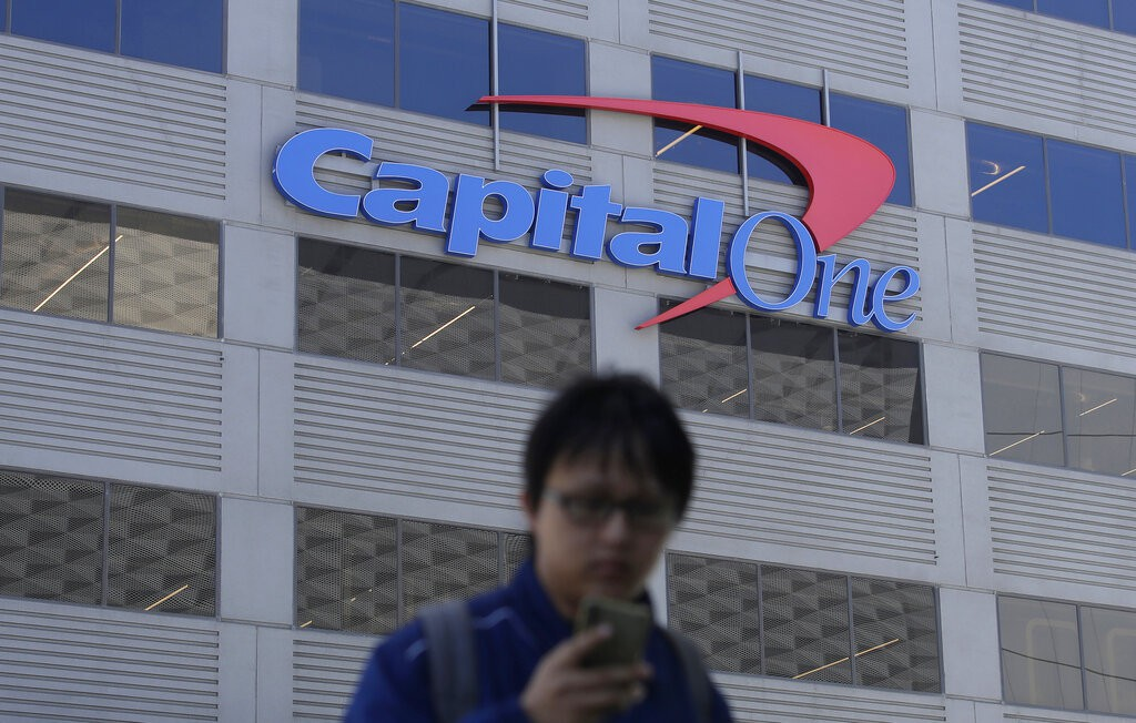 Capital One building with man on phone