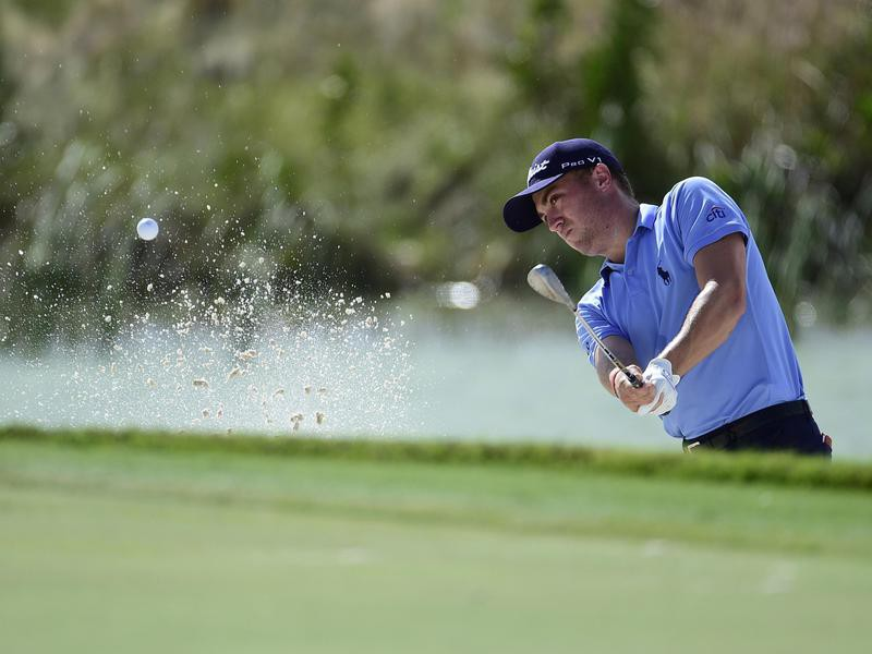 Justin Thomas hits from bunker