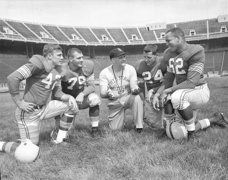 Jim Parker at Ohio State with coach Woody Hayes and teammates