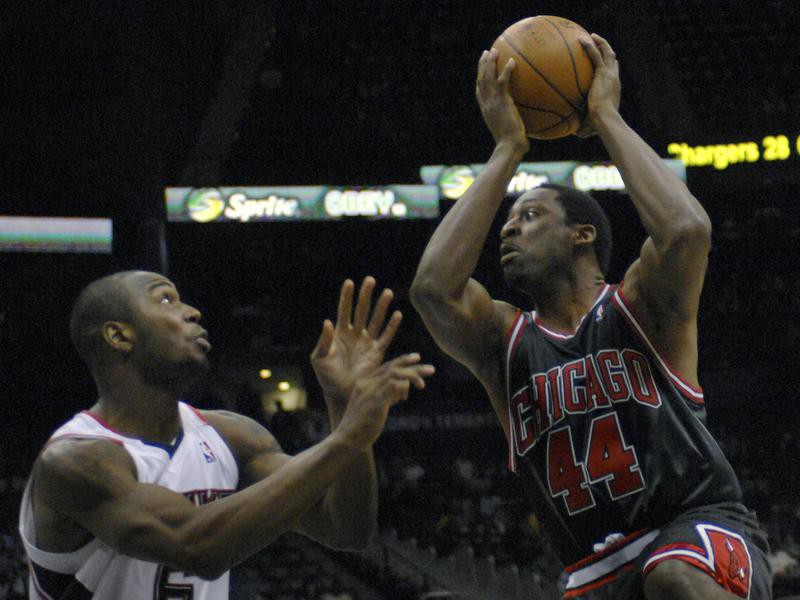 Adrian Griffin looks for shot against Mario West