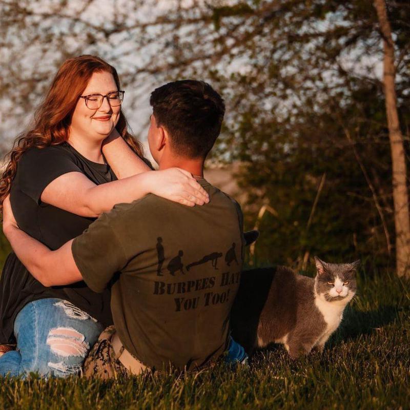 Cat interrupting romantic photoshoot