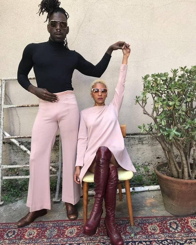 Two people posing in pink outfits
