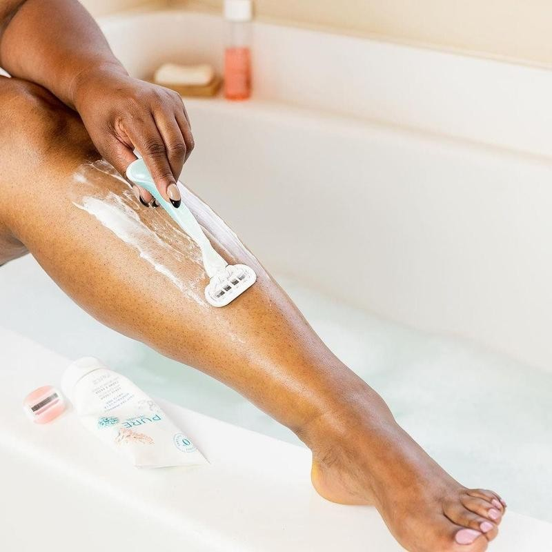 A woman using Gillette Venus Razor to shave her legs
