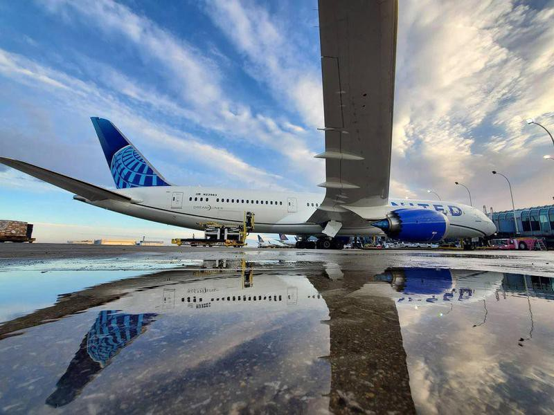 United Airlines aircraft and reflection