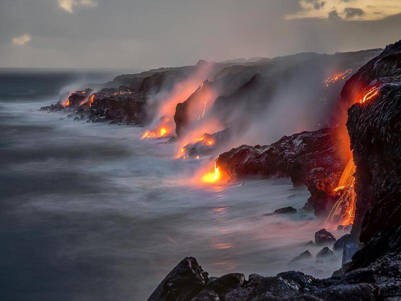 Hot lava entering the ocean in Hawaii Volcanoes National Park