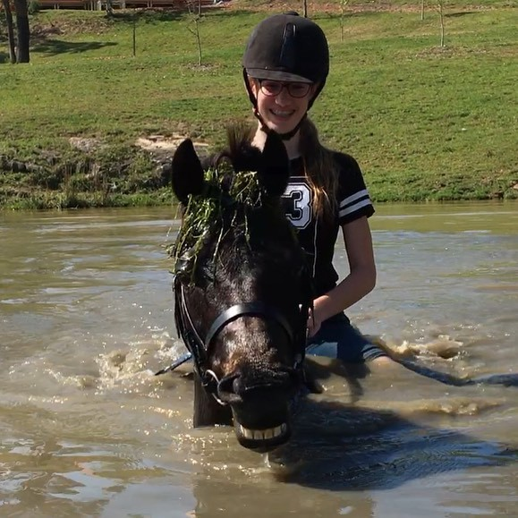Girl Riding Horse in Water