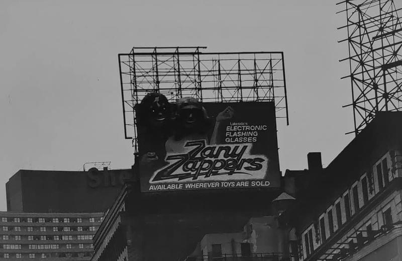 Zany Zappers billboard on building