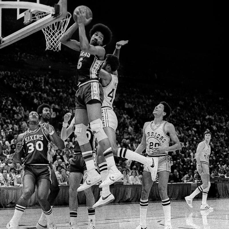 Philadelphia '76ers Julius Erving sweeps rebound