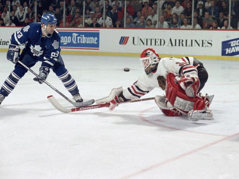 Toronto Blue Maple Leafs' Doug Gilmour watches as Chicago Blackhawks' Ed Belfour makes save