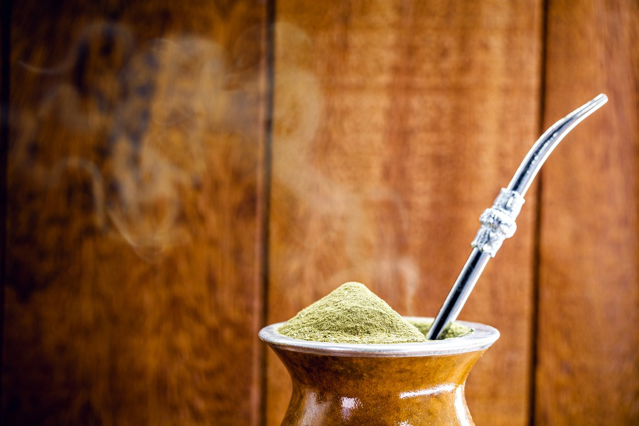Cuia de chimarrão with specific focus on grass and effusion. Typical drink from South America in cold regions.