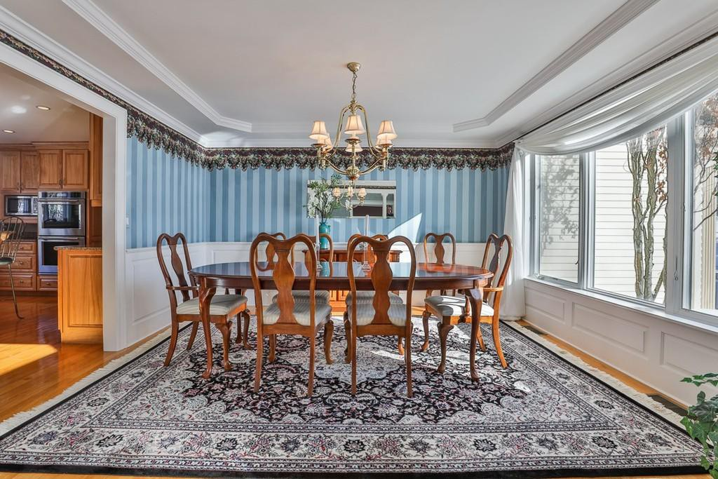 Dining room with blue striped wallpaper