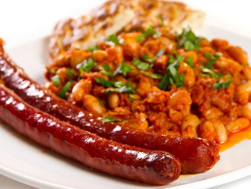 Sausages and beans stew with parsley