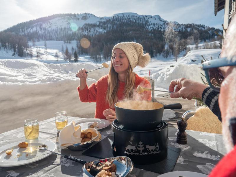 People eating fondue in Switzerland