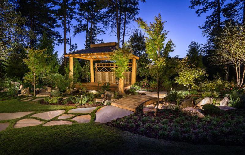 Japanese garden with bridge and night lighting