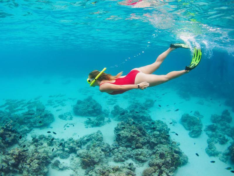 Woman in snorkeling mask