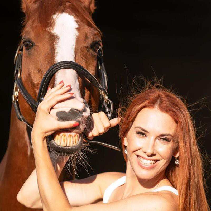 Woman Posing With Smiling Horse