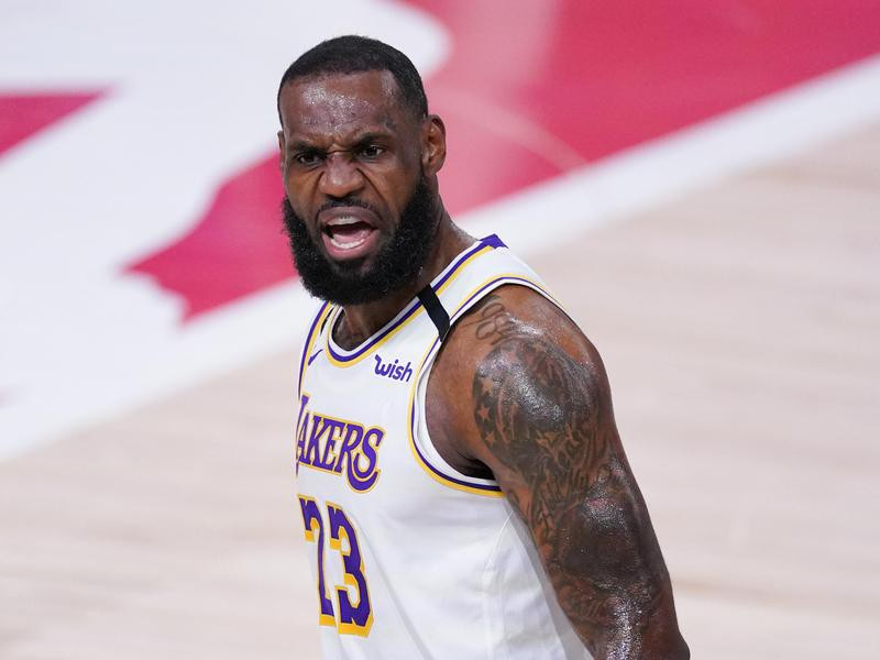 Los Angeles Lakers' LeBron James celebrates after making 3-point shot